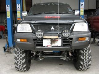 MITSUBISHI L200 4X4 BTV SUSPENSION 7 LIFT KIT TOP OF THE RANGE. NEW