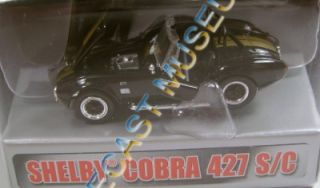 SHELBY COBRA 427 S/C BLACK & GOLD DIECAST 50 YEARS COLLECTIBLES 1962
